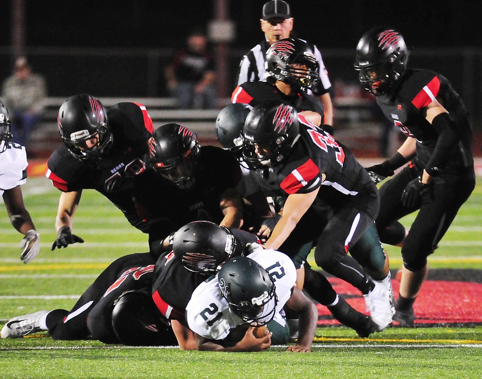 Bradshaw Mountain's defense was swarming the ball carrier in the first half as the Bears take on the Youngker Roughriders in their home opener Friday, August 31, 2018 in Prescott Valley. (Les Stukenberg/Courier)