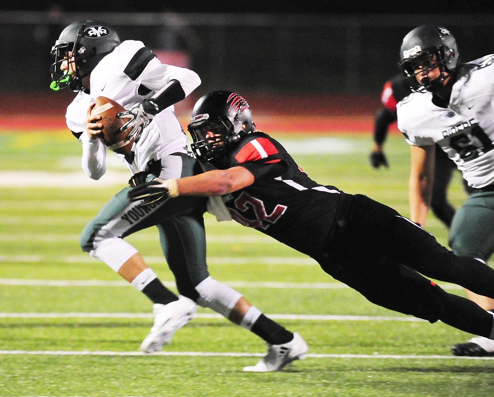 Bradshaw Mountain's Noah Shaver (42) gets the sack as the Bears take on the Youngker Roughriders in their home opener Friday, August 31, 2018 in Prescott Valley. (Les Stukenberg/Courier)