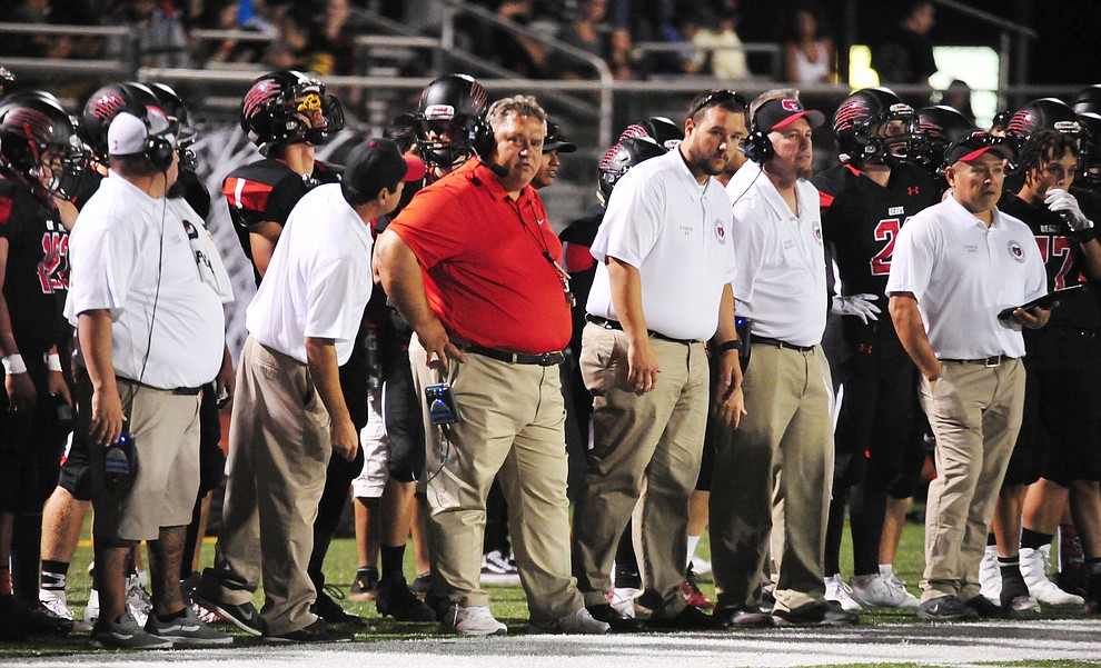 Bradshaw Mountain Head Coach Chuck Moeller and his coaching staff on the sideline as the Bears take on the Youngker Roughriders in their home opener Friday, August 31, 2018 in Prescott Valley. (Les Stukenberg/Courier)