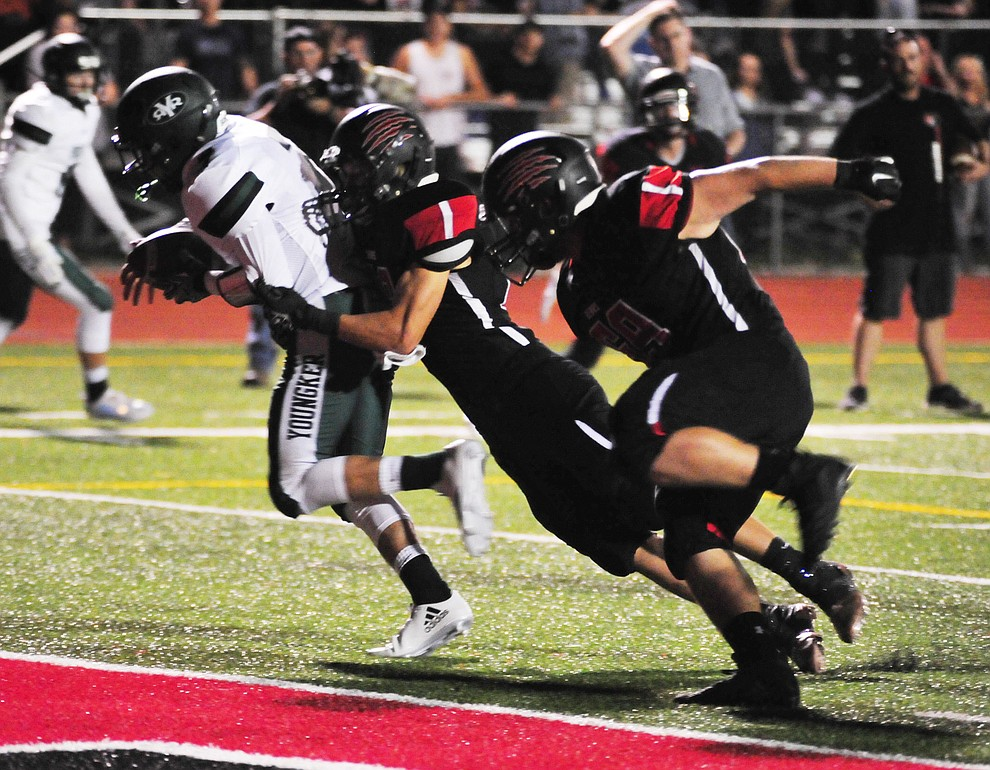 Bradshaw Mountain's Mason Stults (88) gets the sack near the end zone as the Bears take on the Youngker Roughriders in their home opener Friday, August 31, 2018 in Prescott Valley. (Les Stukenberg/Courier)