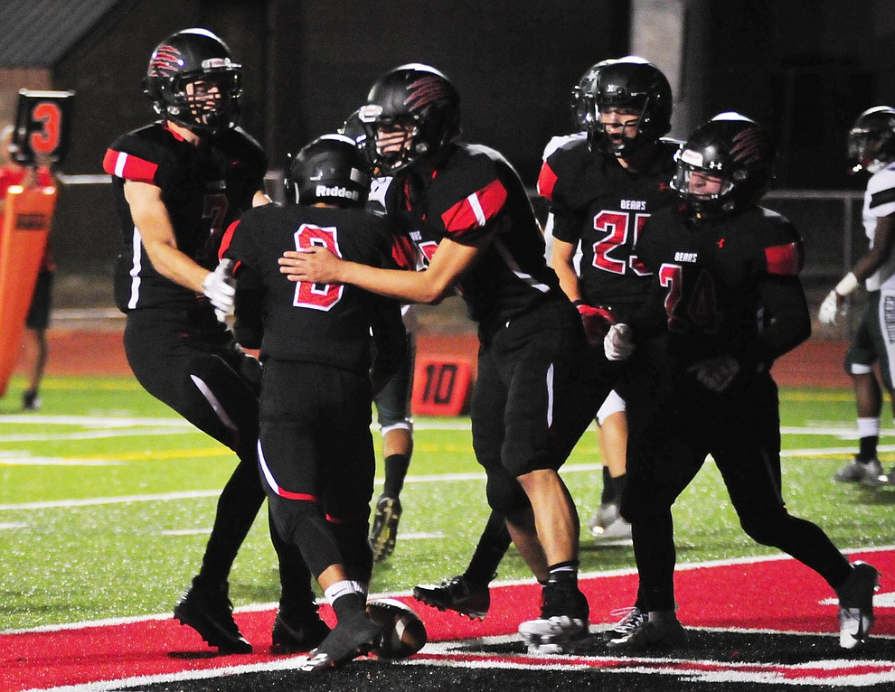 Bradshaw Mountain players celebrate Ruben Gonzalez' (3) touchdown as the Bears take on the Youngker Roughriders in their home opener Friday, August 31, 2018 in Prescott Valley. (Les Stukenberg/Courier)