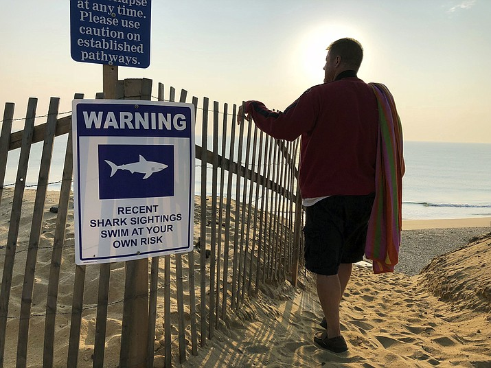 Steve McFadden, 49, of Plattsburgh, N.Y., gazes at Long Nook Beach in Truro, Mass., on Cape Cod, which was closed to swimmers in August after a man was attacked by a shark. Cape Cod authorities said they are concerned about the safety of beachgoers during the Labor Day weekend, but also in the days beyond when lifeguards leave but sharks remain. (William J. Kole, AP Photo File)
