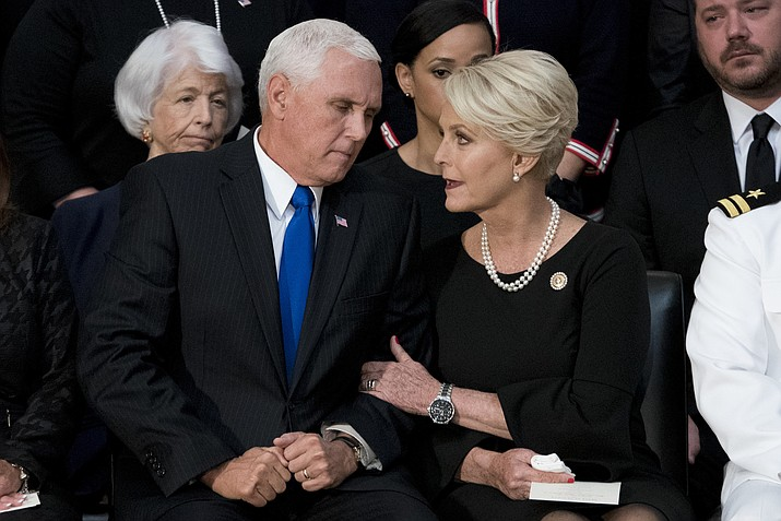 Cindy McCain, wife of Sen. John McCain, R-Ariz., right, talks with Vice President Mike Pence, left, after he speaks at a ceremony for John McCain as he lies in state in the Rotunda of the U.S. Capitol, Friday, Aug. 31, 2018, in Washington. (Andrew Harnik/AP Photo, Pool)