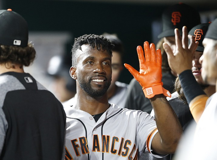 In this Aug. 18, 2018, file photo, San Francisco Giants' Andrew McCutchen, center, is congratulated in the dugout after scoring during the eighth inning of a baseball game against the Cincinnati Reds, in Cincinnati.The playoff-contending New York Yankees are close to completing a trade for San Francisco Giants outfielder Andrew McCutchen. A person familiar with the negotiations told The Associated Press on Thursday night, Aug. 30, 2018,  the Yankees would send infielder Abiatal Avelino and another minor leaguer to San Francisco for McCutchen. The person spoke on condition of anonymity because the deal wasn't finalized. (Gary Landers/AP, file)