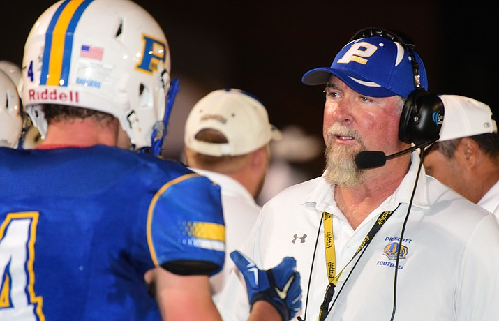 Prescott head coach Michael Gilpin talks to Aaron Greene on the sidelines as the Badgers play Moon Valley on Sept. 15, 2017, in Prescott. Gilpin is currently on leave from the football program while the athletic department conducts an investigation into an incident that happened at practice Wednesday, Aug. 29.  (Les Stukenberg/Courier, file)