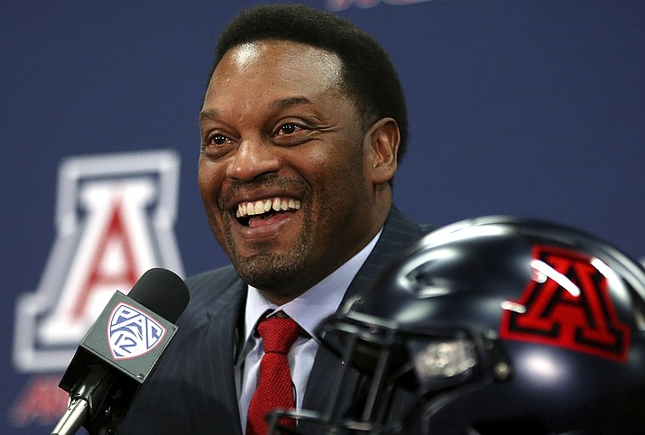 In this Jan. 16, 2018, file photo, new University of Arizona Wildcats head football coach Kevin Sumlin speaks during his introductory press conference in Tucson, Ariz. The Kevin Sumlin Era begins at Arizona on Saturday. The Wildcats should be tested right away with BYU coming to town. (Mike Christy/Arizona Daily Star via AP, File)