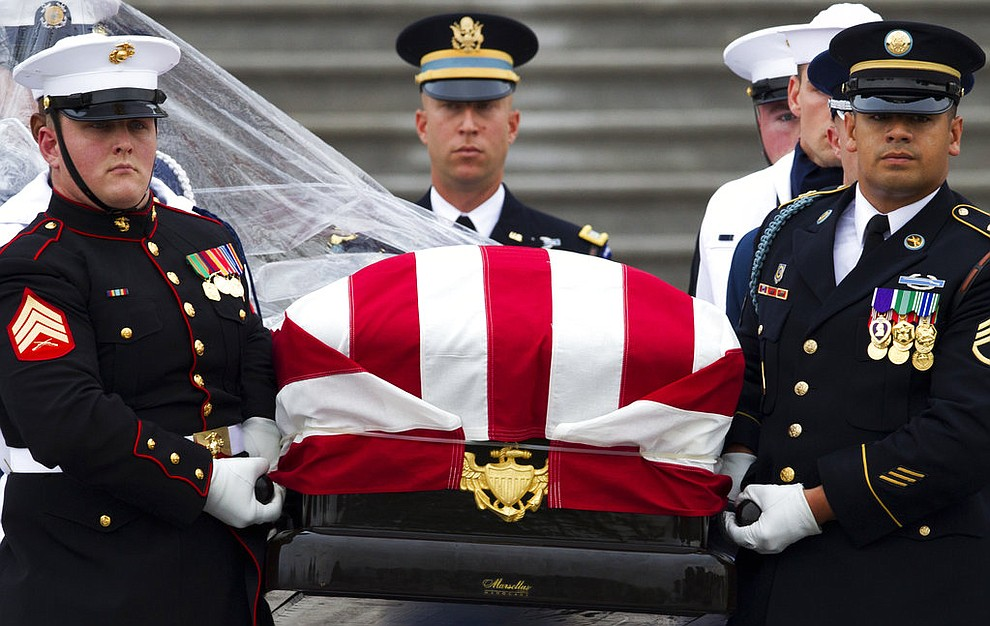 The flag-draped casket of Sen. John McCain, R-Ariz., is carried to a hearse from the U.S. Capitol in Washington, Saturday, Sept. 1, 2018, in Washington, for a departure to the Washington National Cathedral for a memorial service. McCain died Aug. 25 from brain cancer at age 81. (AP Photo/Jose Luis Magana)