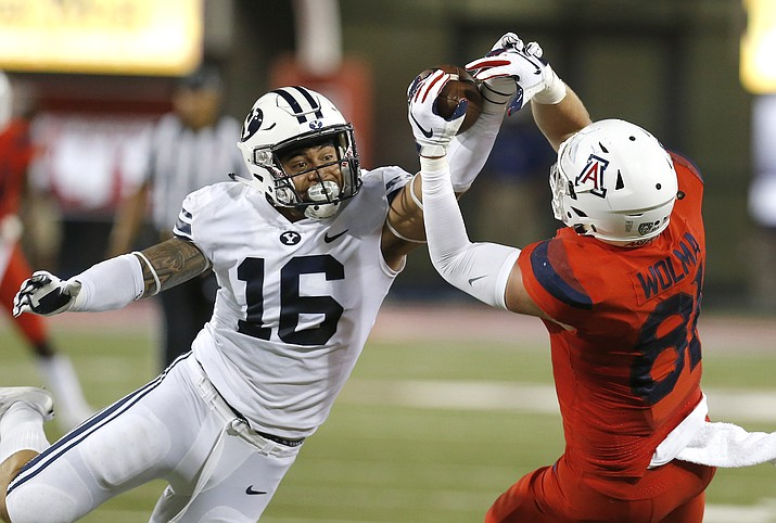 BYU linebacker Sione Takitaki (16) breaks up a pass intended for Arizona tight end Bryce Wolma (81) during the first half of an NCAA college football game Saturday, Sept. 1, 2018, in Tucson, Ariz. (Rick Scuteri/AP)