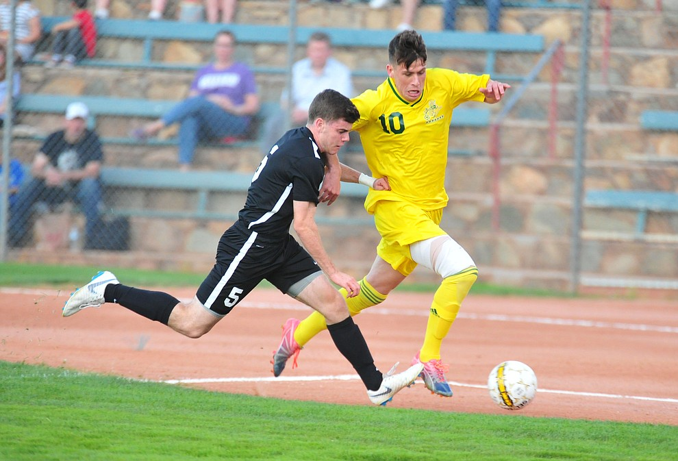 Yavapai's Daniel Mulholland heads for a shot on goal as the Roughriders take on Chandler/Gilbert in their home opener Saturday Sept. 1, 2018 in Prescott. (Les Stukenberg/Courier)