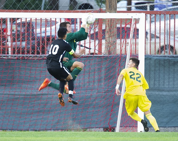Yavapai's Tyler Trump makes a save as the Roughriders take on Chandler/Gilbert in their home opener Saturday Sept. 1, 2018 in Prescott. (Les Stukenberg/Courier)