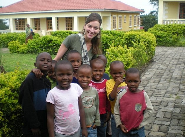 Angie Gwaspika with a group of orphaned children in Tanzania in 2010. The Prescott native has started a nonprofit to help mothers and children in Africa. (Angie Gwaspika/Courtesy photos)