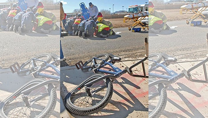 Chino Valley Fire District paramedics, in 2008, work on a child after a minivan hit him while he was riding his bicycle in town. According to CVFD officials, the boy rode out in front of the vehicle. (Courier, file)