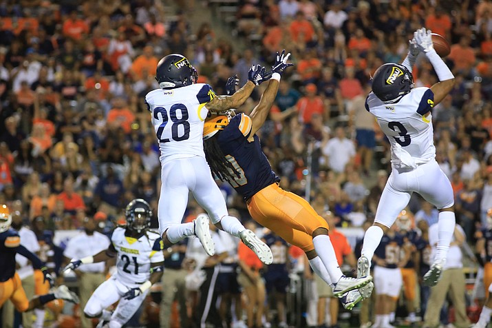 Safety Kam'ron Johnson (3), a senior at Northern Arizona, intercepts the ball against UTEP in a college football game Saturday, Sept. 1, 2018, in El Paso, Texas. NAU won 30-10. (Stayson Isobe, NAU/Courtesy)