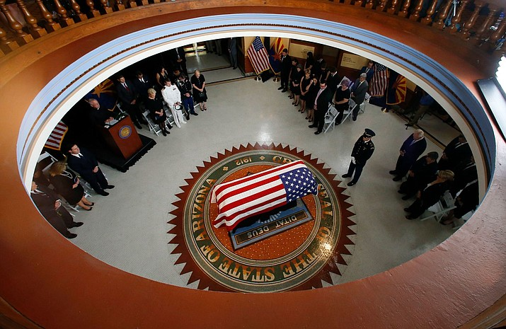 U.S. Sen. John McCain lying in state at the Arizona State Capitol Thursday. (Ross D. Franklin/AP via johnmccain.com)
