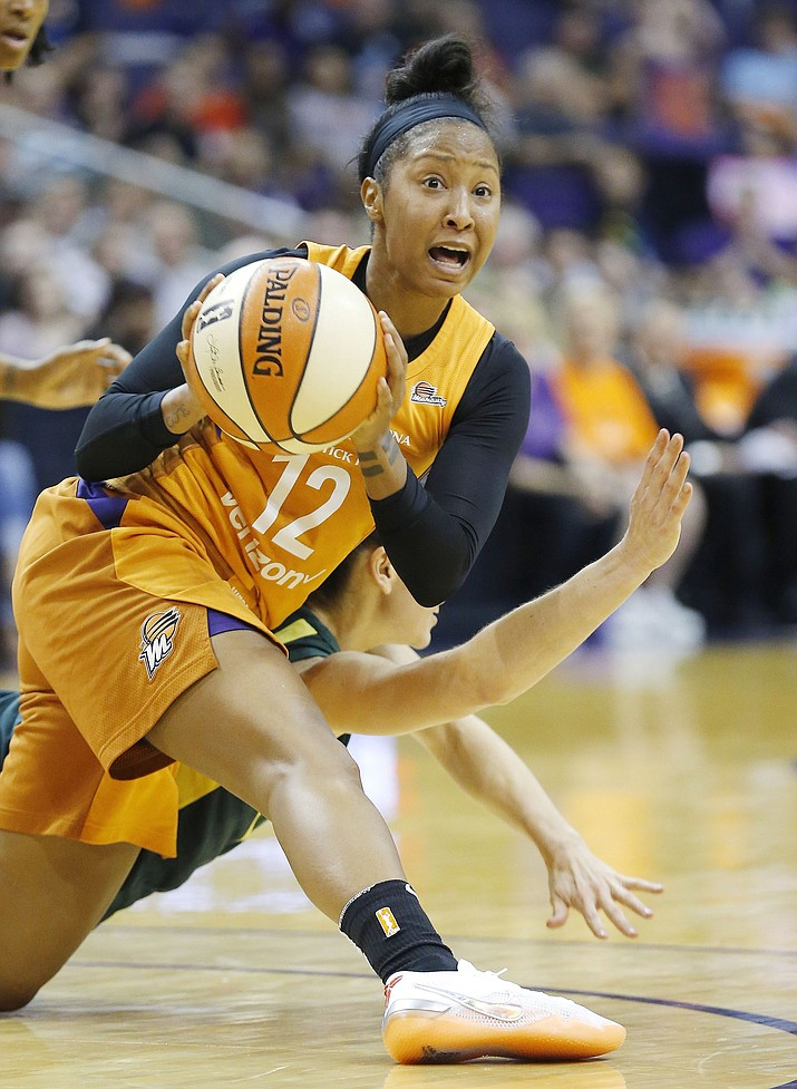 Phoenix Mercury guard Briann January (12) steals the ball from Seattle Storm guard Sue Bird, obscured at lower rear, during the first half of Game 3 of a WNBA basketball playoffs semifinal Friday, Aug. 31, 2018, in Phoenix. (Ross D. Franklin/AP)