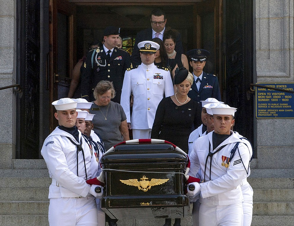 In this image provided by the U.S. Navy, Navy Body Bearers walk with the casket of Sen. John McCain, R-Ariz., followed by family members including Cindy McCain, to place it onto a horse-drawn caisson after his funeral service at the United States Naval Academy Chapel, Sunday, Sept. 2, 2018, in Annapolis, Md. McCain was buried in the cemetery at the Naval Academy. (Mass Communication Specialist 2nd Class Nathan Burke/U.S. Navy via AP)