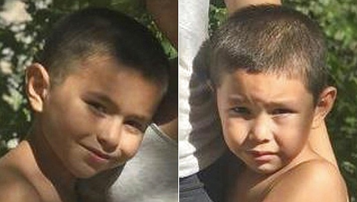 Victor Nunez-Coronado, 8, left, and Jonathan Nunez-Coronado, 5, have been missing since the boys' mother and a male housemate were found fatally shot in the Phoenix home where police said the victims and boys lived. (Phoenix Police Department via AP)