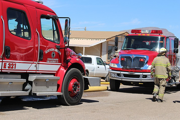 Crews from Northern Arizona Consolidated Fire District respond to a recent fire in north Kingman. Residents of Valle Vista held a meeting in August about NACFD's slow response time to medical calls. (Daily Miner file photo)