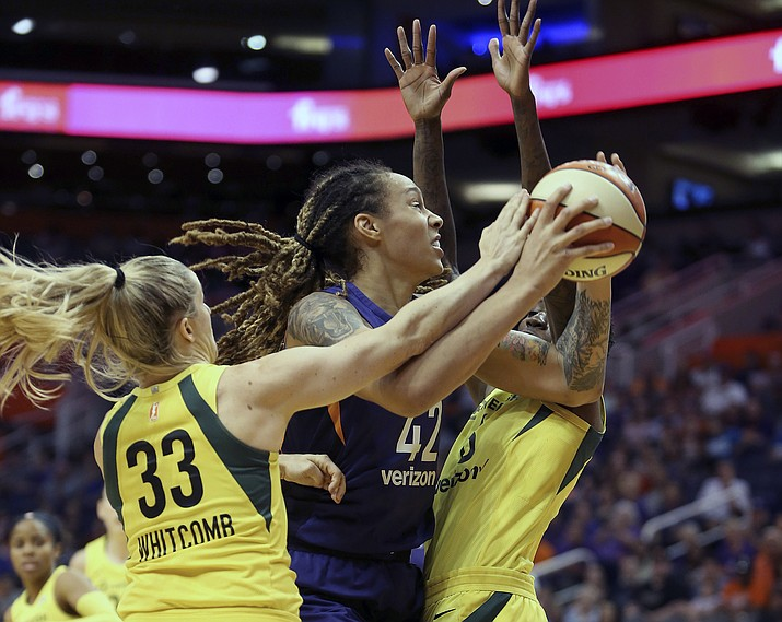 Phoenix Mercury center Brittney Griner (42) is guarded by Seattle Storm's Sami Whitcomb (33) and Natasha Howard as she tries to drive to the basket during the first half of Game 4 of a WNBA basketball semifinals playoff game, Sunday, Sept. 2, 2018, in Phoenix. (Ralph Freso/AP)