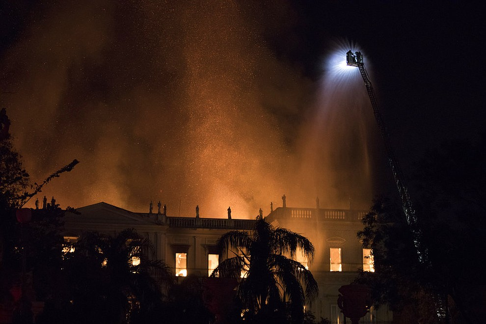 Firefighters work to douse the flames at the 200-year-old National Museum of Brazil, in Rio de Janeiro, Brazil, Sunday, Sept. 2, 2018. According to its website, the museum has thousands of items related to the history of Brazil and other countries. The museum is part of the Federal University of Rio de Janeiro. (AP Photo/Leo Correa)