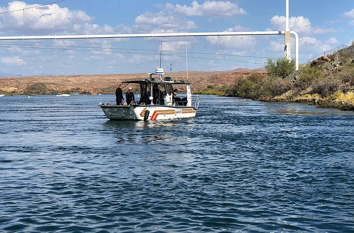 Search and recovery operations continue Monday, Sept. 3, 2018, for three people missing after two boats collided Saturday evening on the Colorado River along the California-Arizona border near Topock, Ariz. The body of a California woman was found Monday, authorities said. A search continued for two other women and one man. (San Bernardino County Sheriff's Office via AP)
