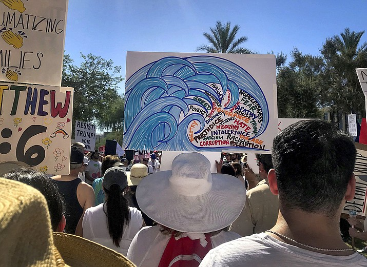 Protesters rally at a Keep Families Together march June 30, 2018, at the Arizona state Capitol in Phoenix. The blue wave Democrats hope will crash into Arizona this November is creeping up in community centers, library auditoriums and churches. (Melissa Daniels/AP Photo)