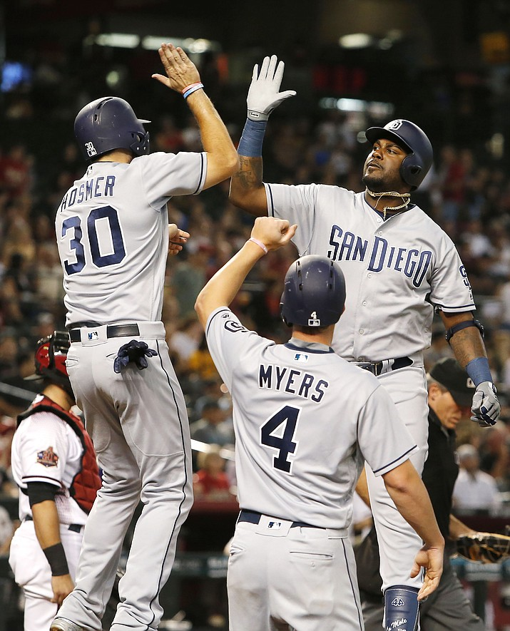 San Diego Padres Franmil Reyes gets a high fives from Eric Hosmer (30) and Wil Myers (4) after hitting a three-run home run against the Arizona Diamondbacks in the second inning during a baseball game, Monday, Sept. 3, 2018, in Phoenix. (Rick Scuteri/AP)