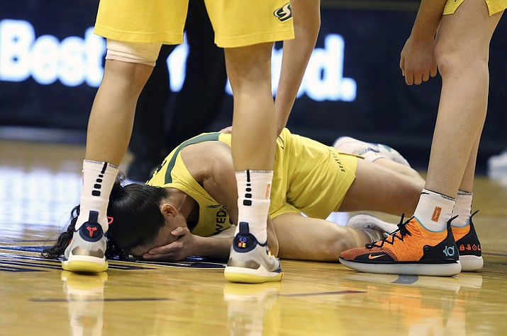 Seattle Storm guard Sue Bird lays on the court after taking an elbow to the face during the first half of Game 4 of a WNBA basketball semifinals playoff game against the Phoenix Mercury, Sunday, Sept. 2, 2018, in Phoenix. Bird would leave the game and not return. (Ralph Freso/AP)
