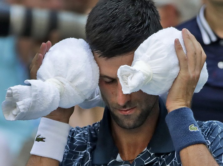 Novak Djokovic, of Serbia, puts an ice towel around his head during a changeover against Joao Sousa, of Portugal, during the fourth round of the U.S. Open tennis tournament, Monday, Sept. 3, 2018, in New York. (Carolyn Kaster/AP)