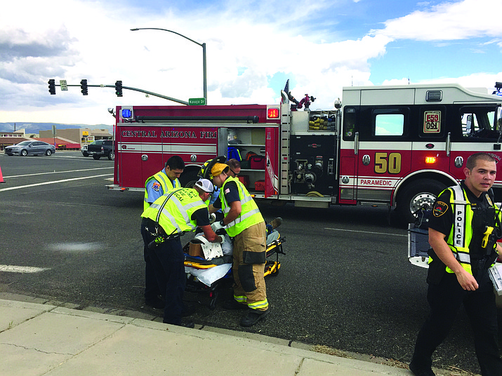 A midafternoon collision between a truck and SUV sent one man to the hospital and temporarily shut down traffic on Highway 69 in Prescott Valley. (George Lurie/Courier)