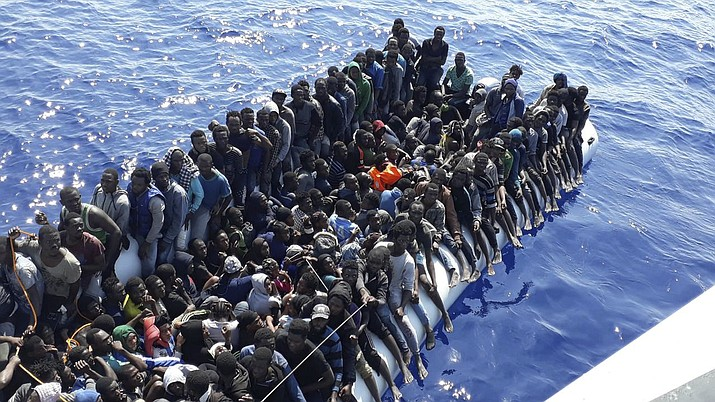 Migrants on a ship intercepted Sunday, June 24, 2018, offshore near the town of Gohneima, east of the capital, Tripoli, Libya. The United Nations refugee agency says people smugglers are taking greater risks to ferry their human cargo toward Europe as Libya's coast guard intercepts more and more boats carrying migrants, increasing the likelihood that those on board may die during the Mediterranean journeys. (Libyan Coast Guard via AP, File)