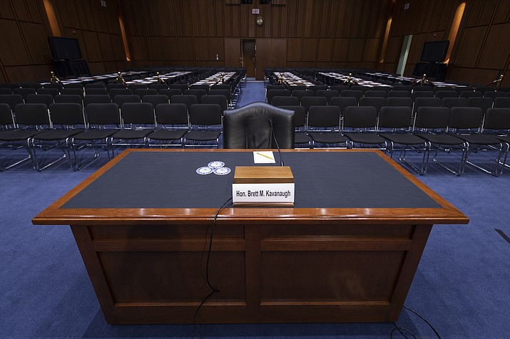 The witness table is prepared for President Donald Trump's Supreme Court nominee, Brett Kavanaugh, in the Senate Judiciary Committee hearing room on Capitol Hill in Washington, Monday, Sept. 3, 2018. (AP Photo/J. Scott Applewhite)