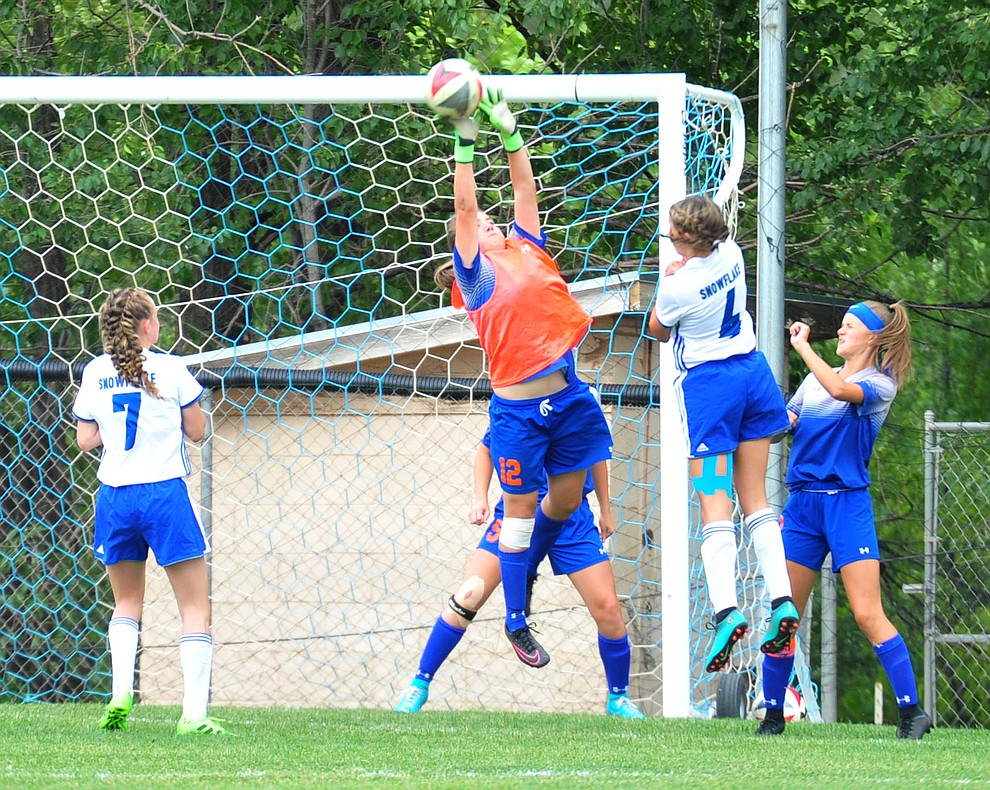 Chino Valley's Kacey Matthews makes a save as the Cougars take on Snowflake at home Tuesday Sept. 4, 2018. (Les Stukenberg/Courier)