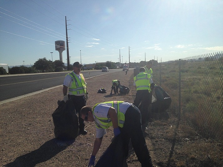 "Volunteers from River Medical ambulance service clean up the road shoulder during a past ""Day of Caring"" hosted by River Cities United Way. This year's cleanup is Saturday, with registration deadline of 5 p.m. Friday. (Submitted photo)"