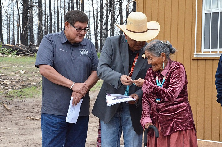 Speaker LoRenzo Bates and Council Delegate Steven Begay hand the key to a new home for Emma Roanhorse in Naschitti, New Mexico Aug. 21. (Navajo Nation Office of the Speaker)