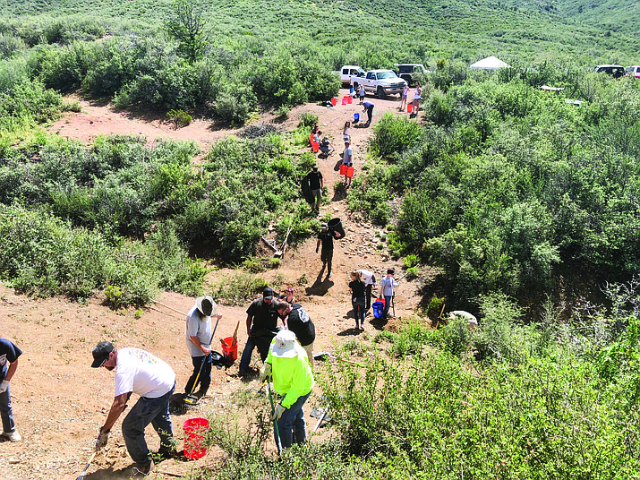 Nearly 120 volunteers pick up and carry out trash from the Doce Pit Recreational area out Iron Springs Road Sept. 1 as part of an annual cleanup day. An estimated 6 to 7 tons of trash was gathered up to be removed from the Prescott National Forest site. (Nicole Corey, Natural Restorations/Courtesy)