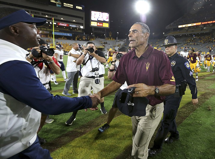 Arizona State head coach Herm Edwards, right, shakes hands with UTSA head coach Frank Wilson following an NCAA college football game, Saturday, Sept. 1, 2018, in Tempe, Ariz. ASU defeated UTSA 49-7. (Ralph Freso/AP)