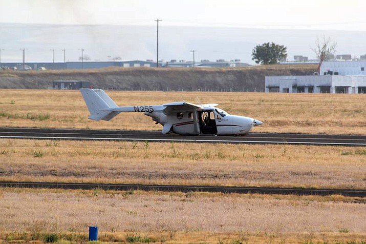 The pilot and passenger avoided injuries after their plane was forced to land on its belly following a landing-gear malfunction Aug. 8. (Photo/Greg Craber)