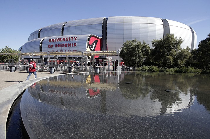 Fans arrive at University of Phoenix Stadium prior to a game between the New York Jets and the Arizona Cardinals on Oct. 17, 2016, in Glendale. The Cardinals announced a deal Tuesday, Sept. 4, 2018, on an 18-year naming rights deal with State Farm. (Rick Scuteri/AP, file)