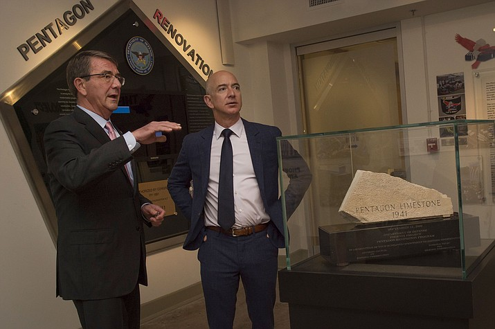 Amazon's founder and CEO Jeff Bezos, right, has a stake in Amazon which is now worth more than $160 billion. As a publicly traded business, Amazon is the second to reach a $1 trillion market value, behind Apple. (Department of Defense photo by Senior Master Sgt. Adrian Cadiz)