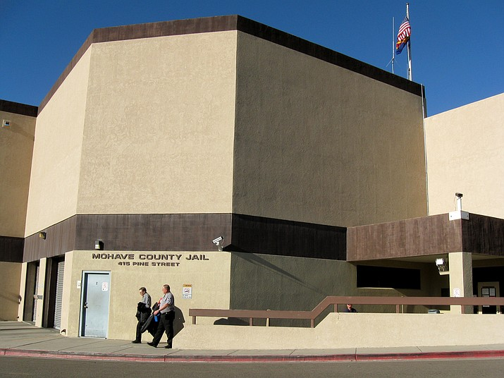 Two officers leave the Mohave County jail on Jan. 28, 2009, in Kingman. The Mohave County Sheriff's Office says it has lifted a lockdown at the county jail. (AP file photo)