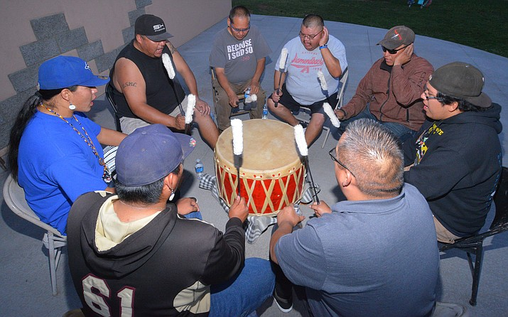 The Standing Horse Drum group plays every Tuesday and Thursday evening in downtown Winslow at the Route 66 Plaza. (Todd Roth/NHO)