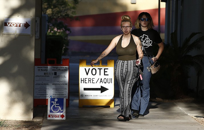Voters exit a polling station on primary election day Tuesday, Aug. 28, 2018, in Phoenix. (Ross D. Franklin/AP)