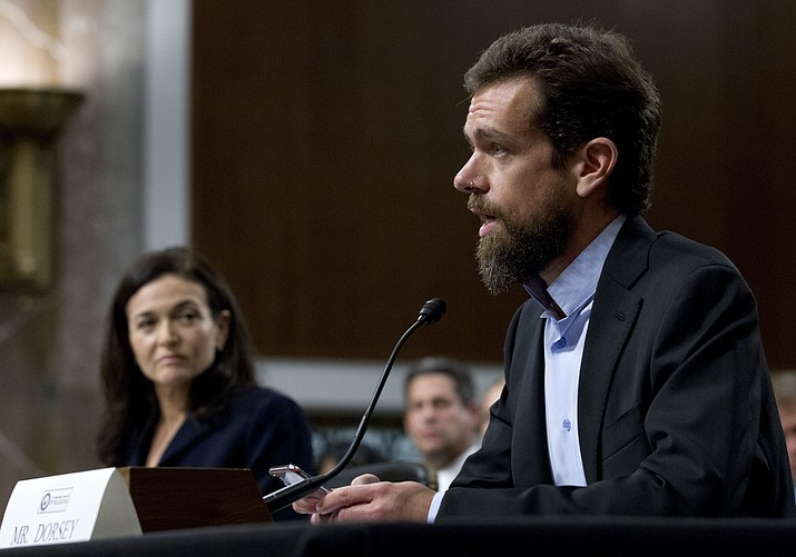 Twitter CEO Jack Dorsey, accompanied by Facebook COO Sheryl Sandberg, testify before the Senate Intelligence Committee hearing on 'Foreign Influence Operations and Their Use of Social Media Platforms' on Capitol Hill, Wednesday, Sept. 5, 2018, in Washington. (Jose Luis Magana/AP)
