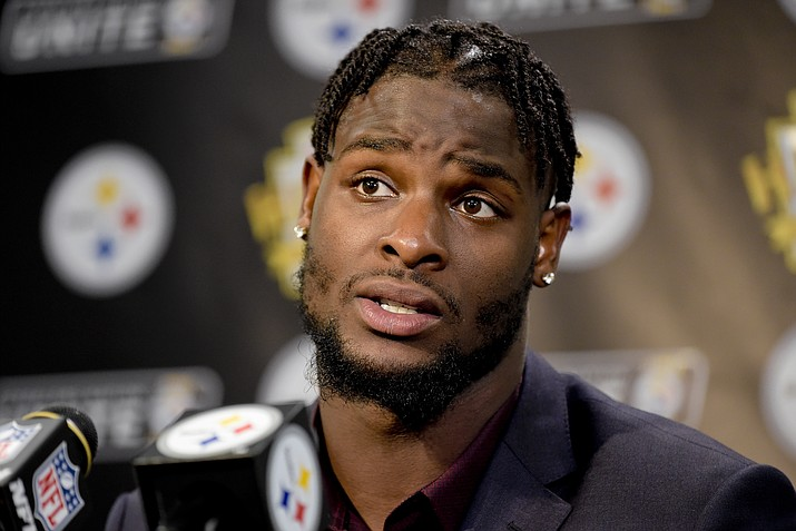 Pittsburgh Steelers running back Le'Veon Bell (26) answers questions at a post-game meeting with reporters following a 29-14 win over the Cincinnati Bengals in an NFL football game in Pittsburgh, Oct. 22, 2017. The Steelers are beginning preparations for their Week 1 opener against Cleveland without All-Pro running back Le'Veon Bell. Bell did not arrive at the team's facility in time for practice on Monday and has yet to sign his one-year franchise tender, leaving his status for Sunday's visit to the Browns in doubt. (Fred Vuich/AP Photo, file)