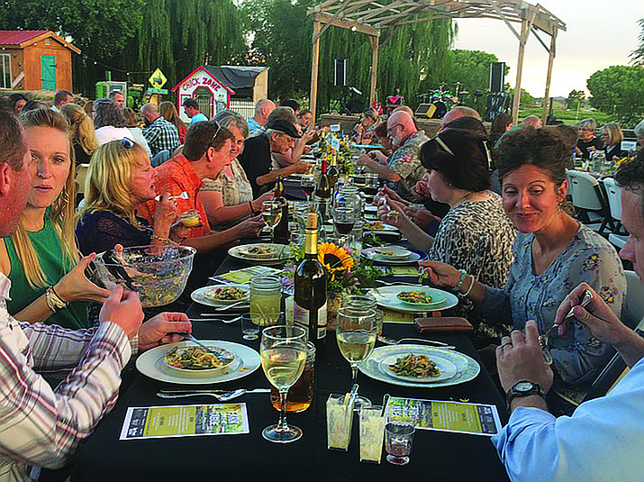 Diners at the Farm to Table event at Mortimer Farms in 2017 begin their dinner experience with a first course of vegetable medley hors d'oeuvres. (Jason Wheeler/Courier, file)