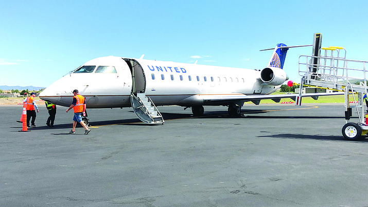 On United Express' third day of operation at the Prescott Regional Airport, strong winds and high temperatures caused the airline (operated by SkyWest) to seek a lighter passenger load on its Prescott-to-Los Angeles flight. Fifteen passengers reportedly volunteered to give up their seats Aug. 31, 2018, in exchange for flight vouchers and incentives. (Cindy Barks/Courier)