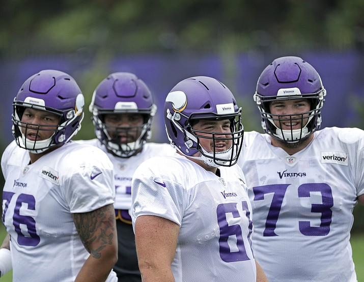 Minnesota Vikings' Brett Jones (61) practices at the NFL football teams practice facility in Eagen, Minn., Monday, Aug. 27, 2018. Vikings center Pat Elflein was held out of the entire preseason while rehabbing from ankle and shoulder surgeries, putting his availability for the opener in doubt. If he's not cleared to play, either Brett Jones or Danny Isidora would snap the ball to Kirk Cousins. (Brian Peterson/Star Tribune via AP)