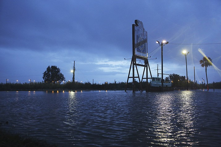 A flooded parking lot sits near a shutdown portion of US Highway 98 from Tropical Storm Gordon on Wednesday, Sept. 5, 2018, in Spanish Fort, Ala. Tropical Storm Gordon never became a hurricane but it was deadly all the same, as it made landfall late Tuesday just west of the Alabama-Mississippi border. (Dan Anderson/AP Photo)