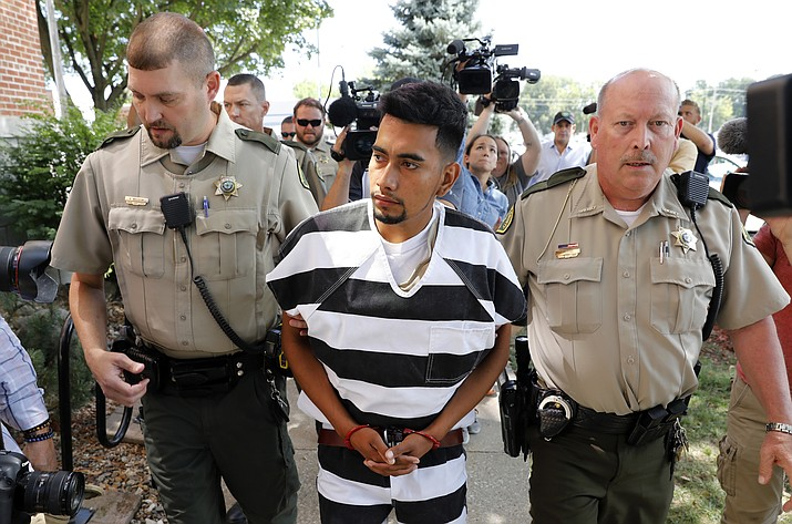 Cristhian Bahena Rivera is escorted into the Poweshiek County Courthouse for his initial court appearance Aug. 22, 2018, in Montezuma, Iowa. Rivera is charged with first-degree murder in the death of Iowa college student Mollie Tibbetts, who disappeared July 18 from Brooklyn, Iowa. The Mexican national was known by another name on the dairy farm where he worked for the last four years: John Budd. (Charlie Neibergall, AP Photo File)